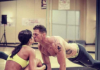 kissing couple at the gym